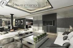 Projekt salonu Inventive Interiors - szary luksusowy salon z wiszącym kominkiem