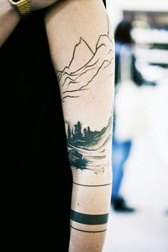 Another forest tattoo design for women. This time around, it has a view of the mountains. It could simply mean a place they wanted to remember. Or it could mean a journey they will never forget.