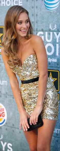 Hannah Davis walked the red carpet at Spike TV's Guys' Choice Awards in a sparkling Lorena Sarbu formfitting minidress. She held onto a black Prada clutch.