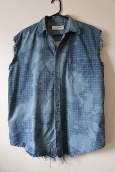 This shirt is a great 90s vintage cotton plaid.  Its a vintage medium weight blue plaid that weve distressed and splatter bleached.  Weve done all the hard work for you, its beautifully frayed and aged strategically all over the shirt - collar, bottom hem, arms holes, etc.  Heres your info on it -  - Size Large, check measurements - Across chest flat, pit to pit - 25 (50 around)  - Shoulder seam down, front - 29  - Shoulder seam down , back - 30  - Neck around inside collar - 17  If you need…
