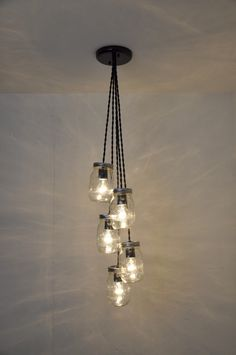 A personal favorite from my Etsy shop https://www.etsy.com/listing/193650094/5-mason-jar-chandelier-pendant-light