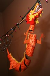 chinese new year dragon out of toilet paper tube sections- 6th Grade loves recycling and will be learning about China in their classroom: Perfect!