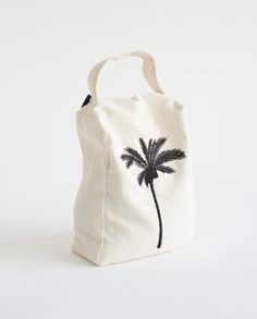 Palm Tree Doorstop. I like it as a tote with the short handle/strap