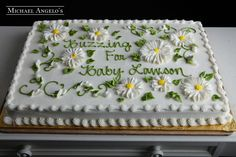 Daisy Sheetcake #47Baby This sheetcake is iced in buttercream with beautiful vines and daisies decorating the top. Add any special message you wish.