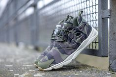 The Reebok Furylite GM Camo features camouflage print through the base with  canopy green 91f3838c3