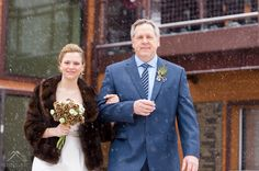 Lake Tahoe winter wedding at a ski resort in a snow storm, pine cone bridal bouquet  © www.tahoeweddingphotojournalism.com