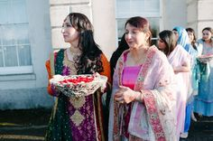 A Muslim Wedding and an Explosion of Colour and Style - silver bowls of rose petals to throw