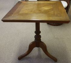 Edwardian Square-Topped Oak Parquetry Table. Top size measures 23 inches x 23 inches and stands at 27 inches tall.