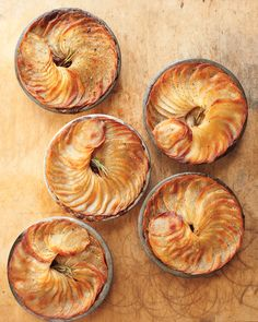 "Braised Short Rib, Stout, and Potato Potpies | Martha Stewart Living - Short ribs stewed in Guinness make up the filling of this Irish meat pie, while crisped potatoes form the top ""crust."""