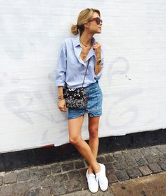 Cotton shirt from Mads Nørgaard, Denimskirt from Acne Studios, Shoes from Superga, Bag from Chanel, Sunglasses from Céline, Snakering from Ole Lynggaard Copenhagen.