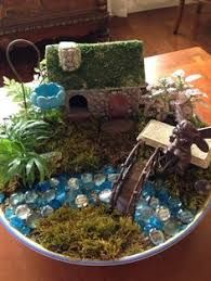 Another DIY fairy garden! I'll have to post a pic of the fairy garden my daughter has that Nana made Mini Fairy Garden, Fairy Garden Houses, Gnome Garden, Fairy Pots, Fairy Gardening, Asian Garden, Chinese Garden, Garden Terrarium, Fairy Garden Accessories