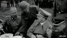 Hitler eating a piece of bread in 1939. He was a vegetarian after 1931 and consumed no animal products aside from liver dumplings on rare occasions.