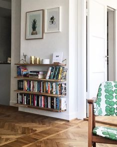 Living room with wooden floor and books