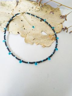This is minimalist blue drops necklace with silver style findings. Very gentle, light and playful necklace which will be ideal addition to many garments in your wardrobe. Measurements: • length of necklace approx. 35 cm/ 13.8 • extender 5 cm/ 2 Materials: • Blue glass beads • Dark blue hematite