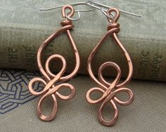 Celtic Loops Copper Wire Earrings - Celtic Knot Jewelry - dangle, handmade, hammered- Celtic Earrings. $18.00, via Etsy.