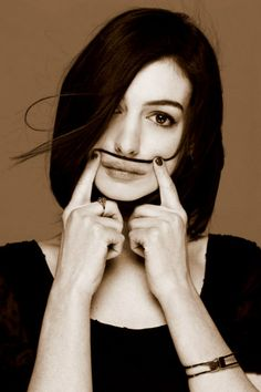 Anne Hathaway and a moustache. Too great.