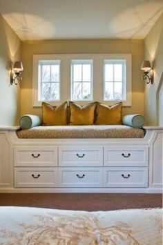 Window seat with storage and sconces