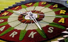Floral Clock from the side with red and yellow design Big Garden, Dream Garden, Outdoor Projects, Garden Projects, Niagara Falls Attractions, The Watch Shop, Garden Clocks, Floral Clock, Color Splash Photo