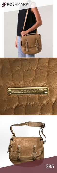 "Rebecca Minkoff Logan Brown Satchel Crossbody Bag Great used condition Rebecca Minkoff Logan bag. Satchel style with adjustable crossbody strap. Tan fatigue color pebbled leather. Studded front straps, exterior cellphone pocket (does not fit Apple plus size phones). One interior zip pocket and 2 slip pockets. Signature Rebecca Minkoff lining. Overall really nice condition. Some wear and dye transfer on bottom corners. Inside is clean. Approx 12""h x 14""w x 4""d. Rebecca Minkoff Bags Satchels"
