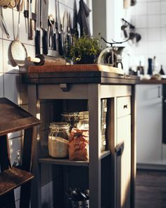 One way to give your kitchen a traditional style look is by using glass jars to display foods like flours and pickles as well as clear bottles for flavoured oils and vinegars.