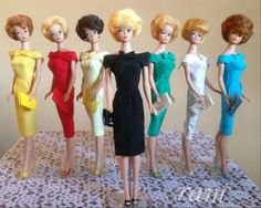 Bubblecut Barbies wearing pak sheaths in all the colors. From the collection of Rosalie A. McFarlane.