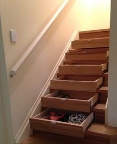 Understairs storage - The Stairpro InStep Drawer™ is an innovative storage solution that makes convenient storage of a once unusable space under the staircase.  Make the most of your living space.  The solid timber dovetailed drawers are designed to reuse the existing riser board as the drawer front, they are smooth running, and are soft-closing. Perfect!
