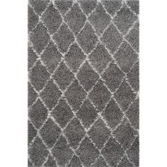 Anchor your living room seating group or define space in the den with this loomed shag rug, featuring a diamond trellis motif.      ...