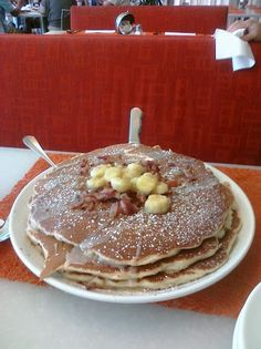HUGE pancakes at Mac 24/7 in Oahu.  This was on Man vs Food on foodnetwork.  We got the one with bacon, banana, and peanutbutter!  THis is what it looked like when they brought out.........
