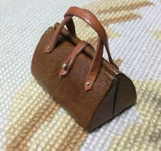 """Pat Tyler Artist Made Handcrafted Natural Genuine Leather Luggage Gatsby Bag with leather trim measures approximately 1 3/4 Wide, 1"""" High and 1"""" Deep Scale: 1 inch equals 1 foot"""
