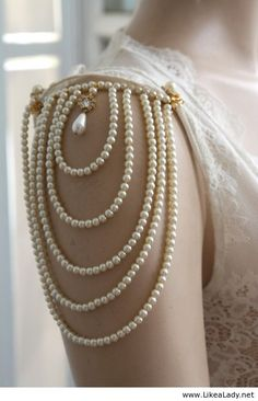 Pearl sleeves ~ This would be a gorgeous detail on a blouse | THIS IS A TOTALLY DIY PROJECT FOR cents on the dollar of an original (: Wear with Black pencil skirt and beige lace heels. Hair in an up do, natural makeup and soft peach tinted lips.
