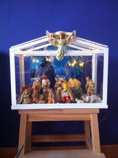 Nativity in an Ikea greenhouse hack / kerststal / Christmas The background is a Christmas album.