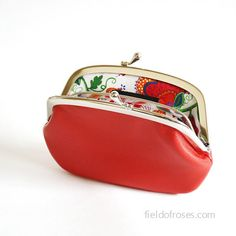 Womens leather wallet has a divider in the middle.  Lambskin red leather. Lined with beautiful Liberty of London fabric. Limited.  Size: