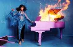 alicia keys. piano blazing. this photo is like her career for the last decade: on fire.