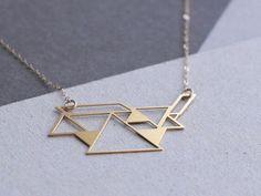 https://www.etsy.com/dk-en/listing/119853025/tangram-necklace-geometric-jewelry?