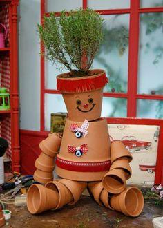 Vaso enfeite de jardim feito com vasos de barro