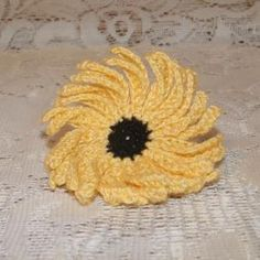 Black Eye Susan Free PDF download available at:  download now Skill Level:   Easy Supplies:  Size 10 black and yellow cotton crochet thread; size B/1/2.25mm crochet hook, (or size 3 steel crochet h...
