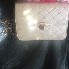 Shell Nude Quilted Purse Adorable quilted purse with a heart closure and hearts in the pattern! Bags Crossbody Bags