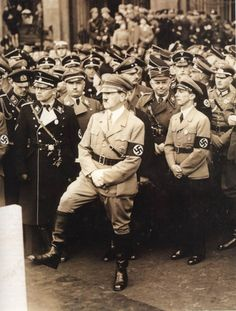 Adolf Hitler and Joseph Goebbels in the foreground with others high rank Nazi officers.