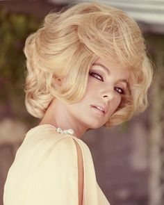 Virna Lisi, Italian actress, wearing a yellow top with slashed sleeves, with a blonde bouffant hairstyle, circa 1960.                                     via @AOL_Lifestyle Read more: http://www.aol.com/article/2015/01/03/the-story-behind-hairspray/20577435/?a_dgi=aolshare_pinterest#slide=14694 fullscreen