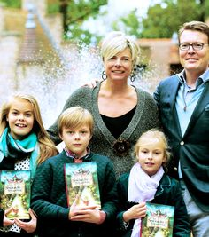 anythingandeverythingroyals:  Princess Laurentien and Prince Constantijn with their three children Countess Eloise, Count Claus-Casimir and Countess Leonor at the Dutch amusement park Efteling; the children have copies of their mother's newest book De Sproojkes Sprokkelaar, which she co-wrote with Paul van Loon.