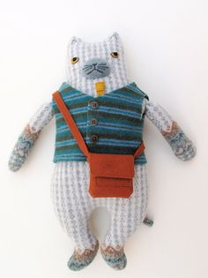 Doll, the art and craft of Mimi Kirchner. Adorable felted sweater vest here.