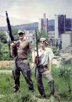 Bosnian volunteers pose outside of Sarajevo, one of them with an M53 light machine gun