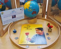 What is the significance of a Peace Table in a Montessori environment, and how can we promote the concept of peace to little individuals!