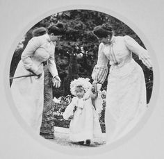 Toddler Anastasia on the hand of her mother