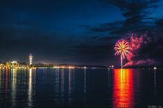"""AccuFan Weather Photo of the Day: Fireworks over the bay at dusk in Erie, Pa., by """"AntonB"""" 7/4/13."""