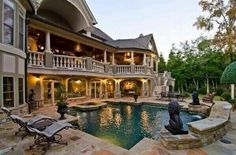 Backyard with a multi level wraparound balcony. Backyard with a multi level wraparound balcony.findinghomesi… Backyard with a multi level wraparound balcony. Big Houses, Pool Houses, Future House, My House, Dream Mansion, Mansion Houses, House Goals, My Dream Home, Dream Homes