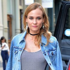 Pin for Later: Diane Kruger Changed 3 Times in 24 Hours, But 1 Piece Stayed the Same  She paired the outfit with feather earrings to achieve a bohemian vibe.