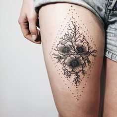 Thigh flower and dot tattoo