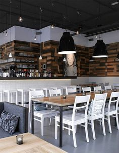 Like the white chairs and stools mixed in the wood tables and counter...clean