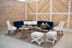 We're loving the modern simplicity of this styled shoot at Barr Mansion captured by Melissa Glynn Photography. The brick and wooden geometric walls of the venue are the perfect backdrop for the chic navy and cream lounge setting.